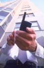 金融商业0289,金融商业,商业金融,高楼大厦 手机 双手 衬衣领带