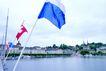 瑞士风情0018,瑞士风情,世界风光,旗帜 倾斜 河边 远处 建筑