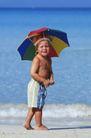 健康休闲0175,健康休闲,运动,海边 孩童 伞帽