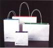 靳与刘设计顾问0018,靳与刘设计顾问,中国设计机构年鉴,纸盒  绳子 串着 提  作用 空 工具