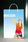 锦绣风云旅行社0008,锦绣风云旅行社,企业广告PSD分层,旅行袋 印刷 美女