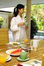 居家休闲0066,居家休闲,综合,居家女人 餐桌 橙汁