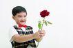 儿童广告0056,儿童广告,儿童,红领结 俏皮表情 双手拿玫瑰