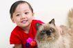 儿童生活0038,儿童生活,儿童,小猫 红衣小女孩 胸前红花