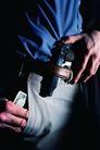 犯罪纪实0004,犯罪纪实,人物,皮带 别在腰间 一把手枪